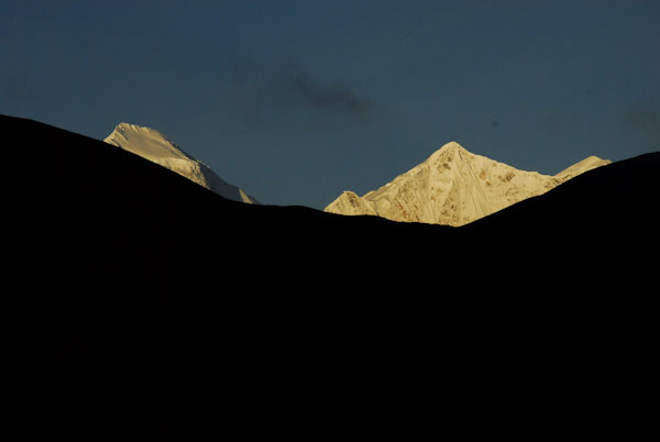 Tukuche peak and Dhaulagiri poke their heads into the sunrise. Jharkot, Nepal