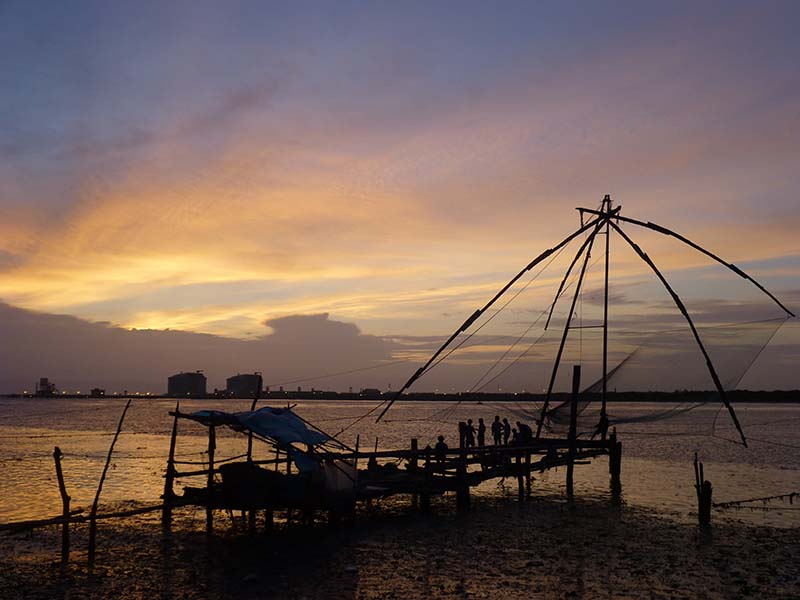 Chinese style fishing nets in the sunset.