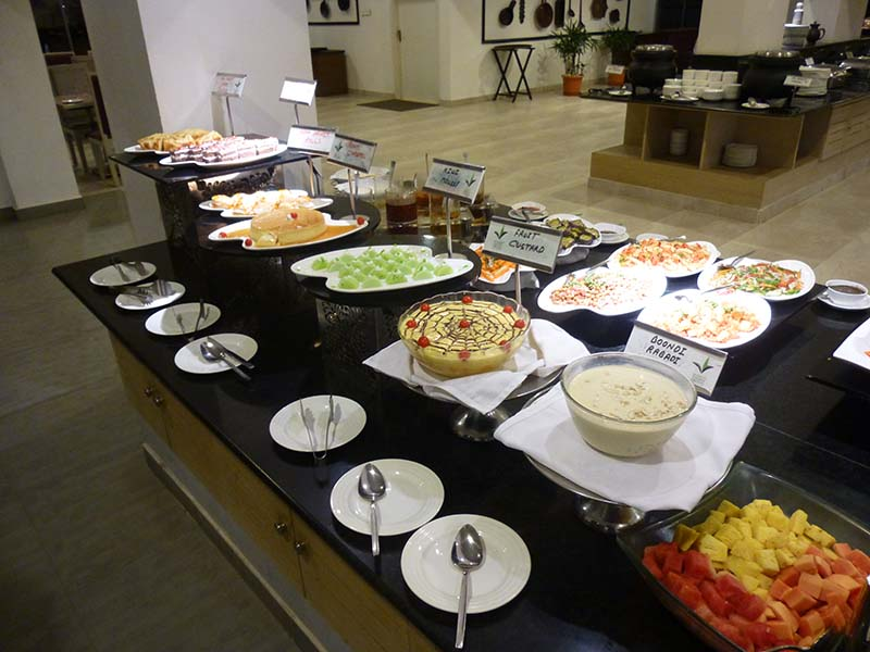 The buffet dinner - deserts on this side, salads on the other and hot dishes in the background.